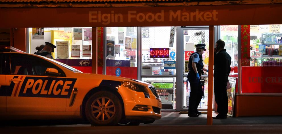 Police at the Elgin Food Market after the robbery in July. Photo: Stephen Jaquiery