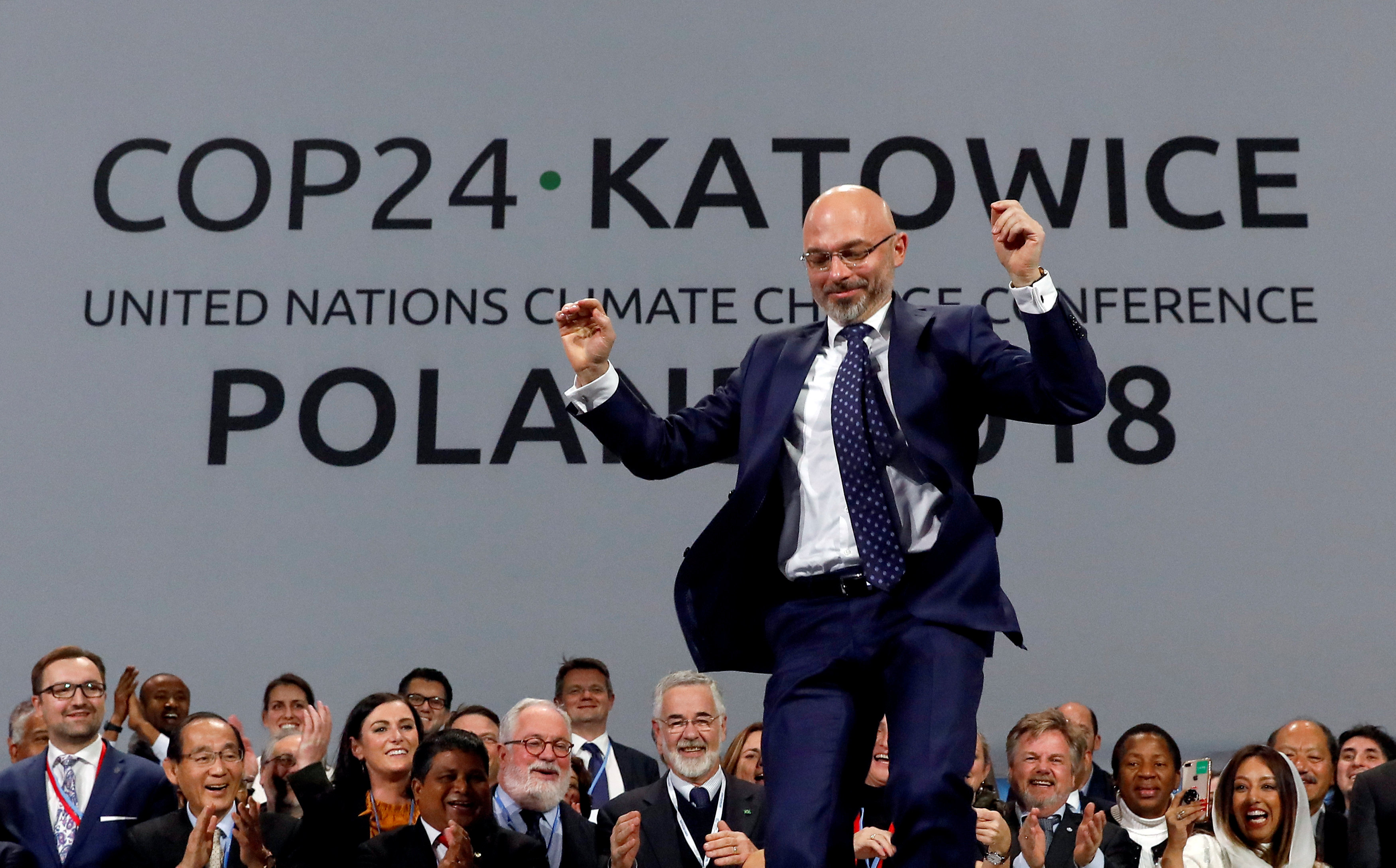 President of the talks Michal Kurtyka celebrates during the final session. Photo: Reuters