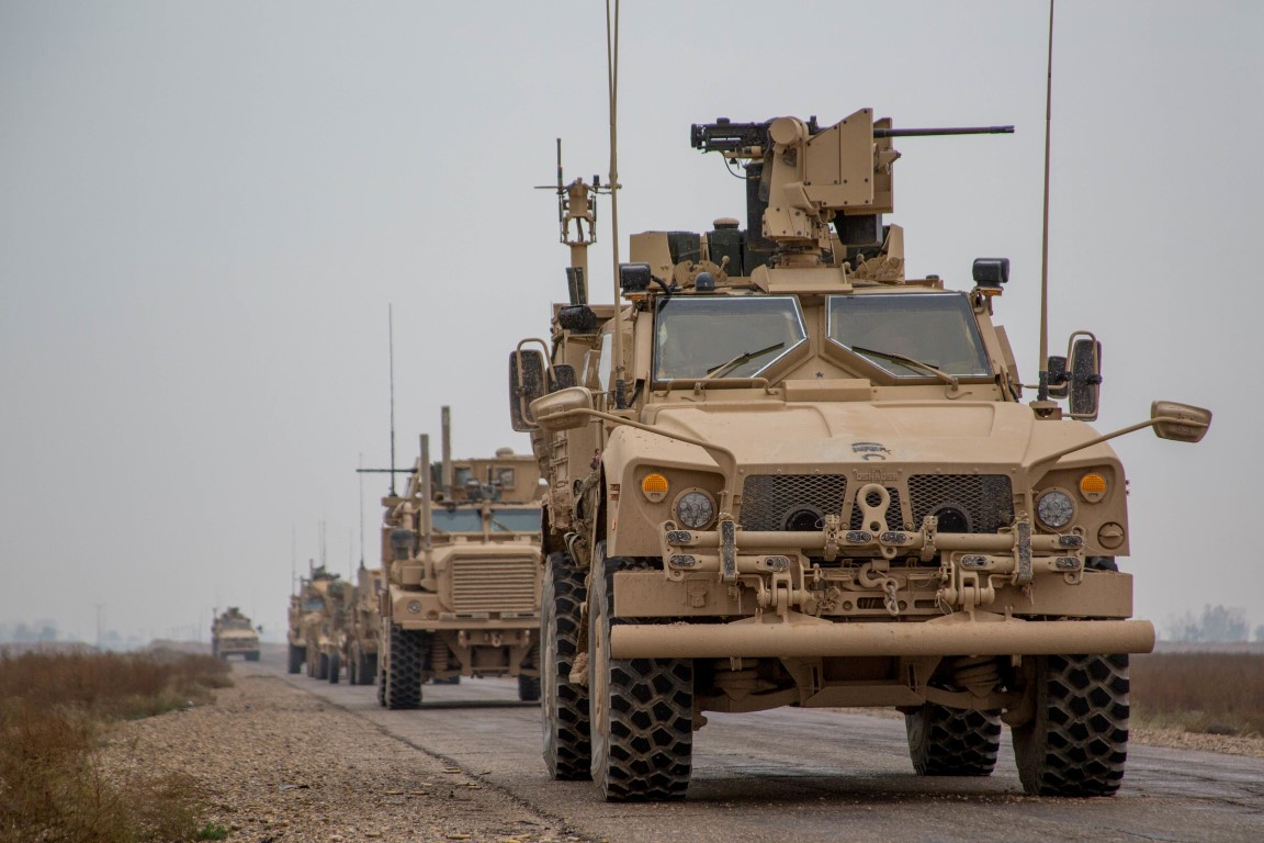 Armoured vehicles belonging to US-led coalition forces in the Middle Euphrates River Valley in...