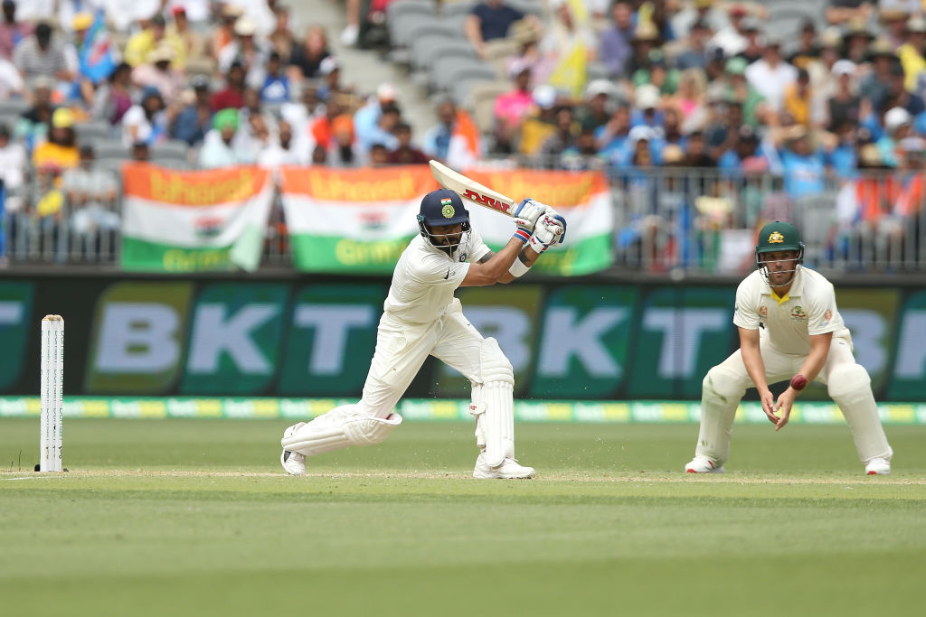India's Virat Kohli on the drive against Australia on day two of the second test. Photo: Getty