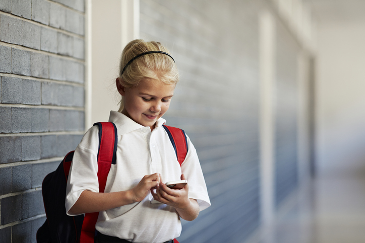 A psychologist who led the review said mobile phones posed a risk to children. Photo: Getty