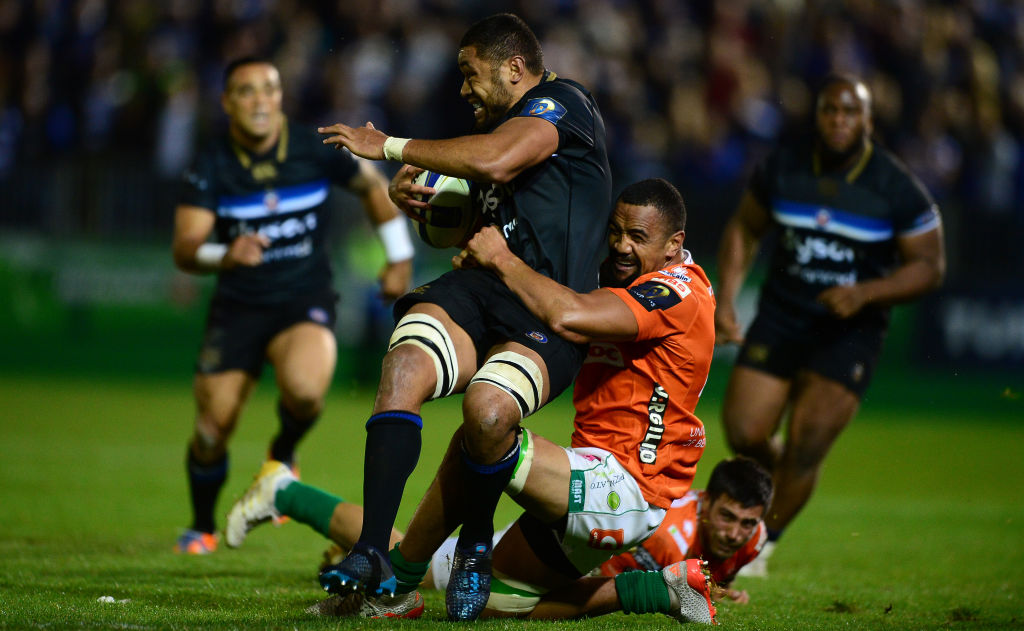 Benetton's Nasi Manu (R) tackles Bath's Taulupe Faletau during a European Rugby Champions Cup...