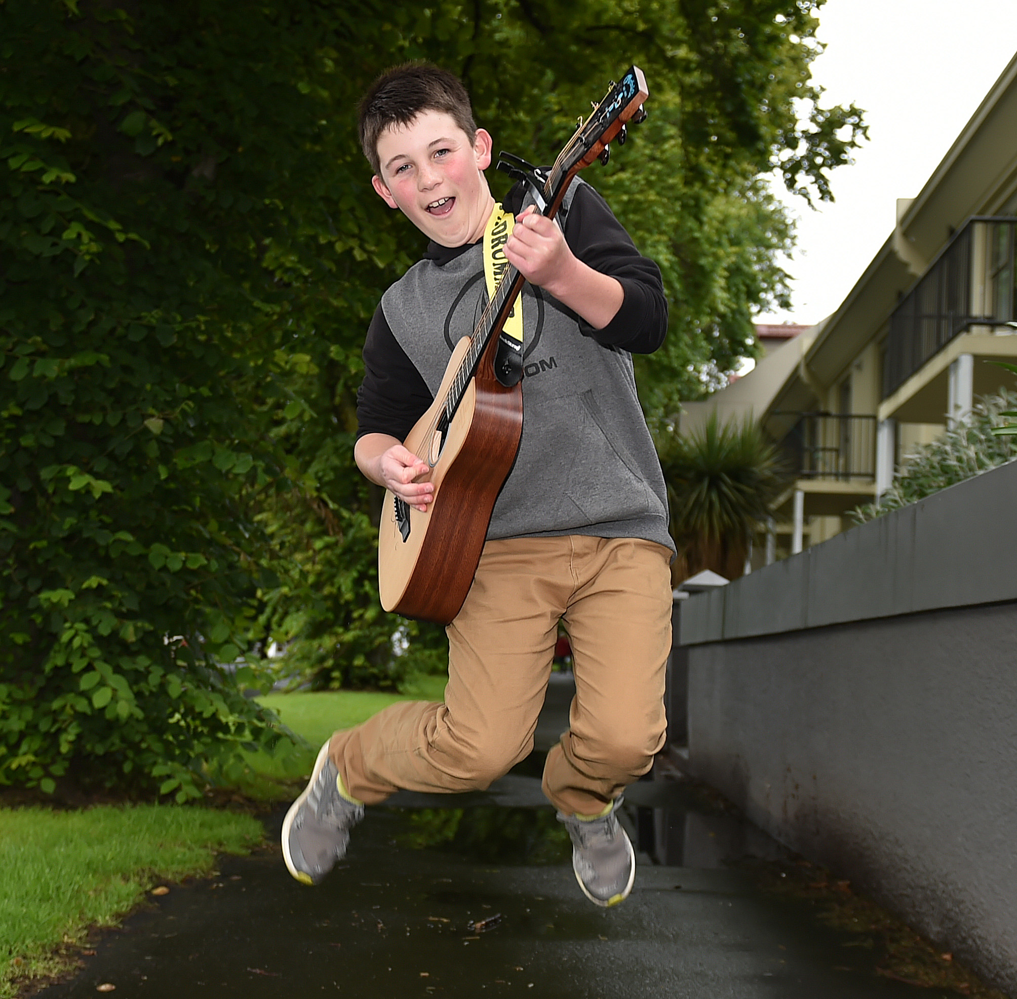 Busker Rylan Urquhart (13), of Dunedin, gets amped up to entertain Shania Twain concert goers...