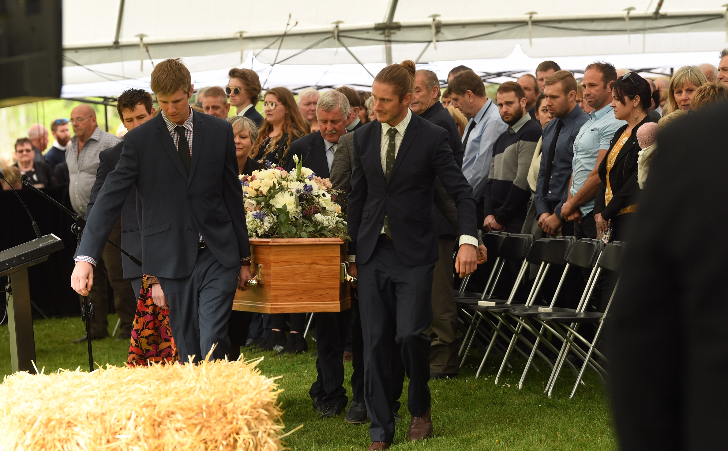 The casket with Nadine and her son Angus Tomlinson is carried to their funeral service. Photo: ODT