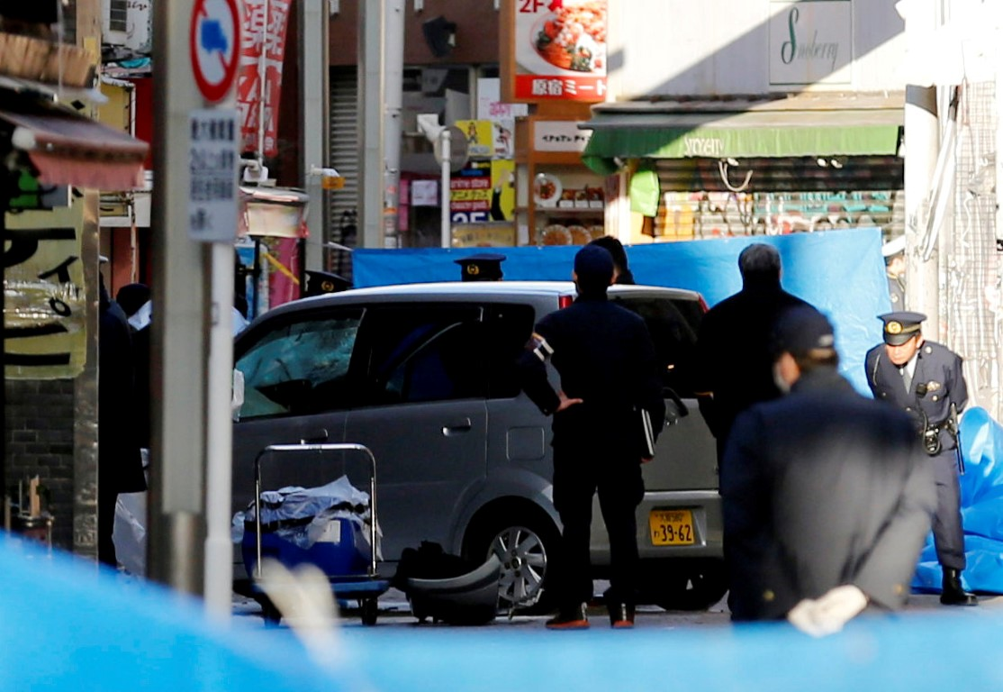 Police at the scene in Tokyo on Tuesday morning. Photo: Reuters