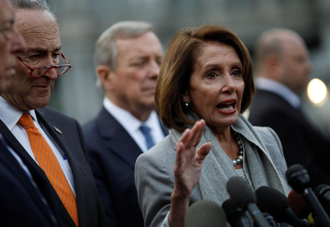 US Senate Minority Leader Chuck Schumer and Speaker of the House Nancy Pelosi speak to media...