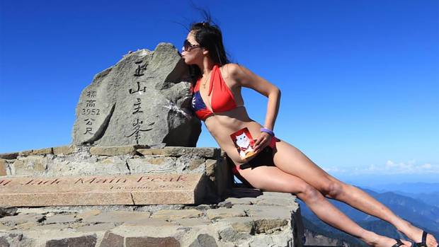 On the eighth day of her solo hike, Gigi Wu, 36, used a satellite phone to call a friend after...