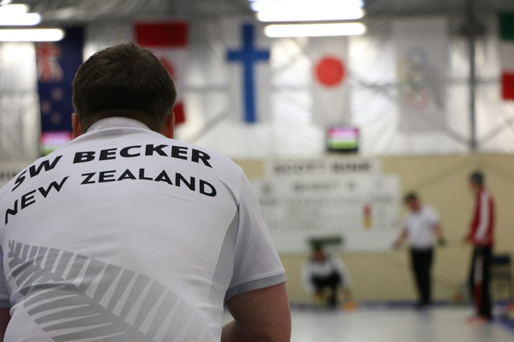 New Zealand men's skip Scott Becker watches as his teammate prepares to release a stone Photo: RNZ