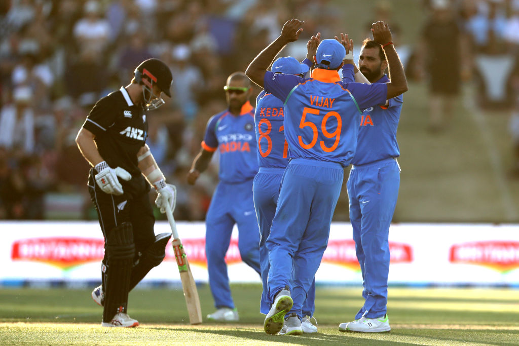 ae7d5d6bb16 Indian players celebrate the dismissal of New Zealand s Kane Williamson.