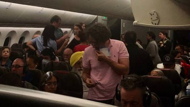 Passengers on American Airlines flight 82 that had to be diverted to Honolulu after a passenger...