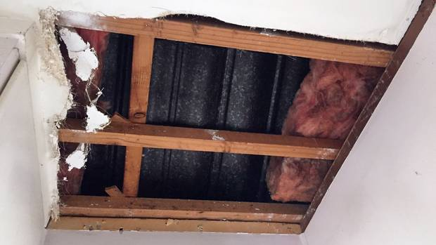 The hole left in the ceiling of 82-year-old Greenlane woman Heidrun Leonard's house by two people who scammed her out of $8800. Photo: NZ Herald