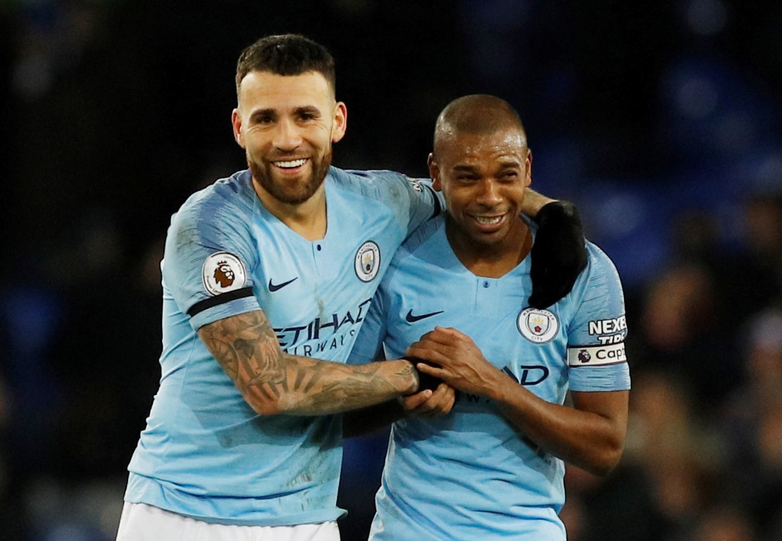 Manchester City's Nicolas Otamendi and Fernandinho celebrate their victory. Photo: Reuters