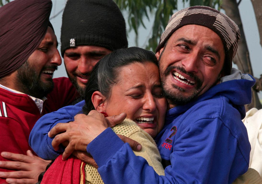 Relatives of a Central Reserve Police Force member who was killed in the attack show their grief...