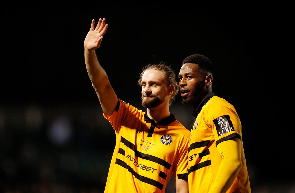 Newport's Fraser Franks and Jamille Matt salute their fans after the match Photo: Reuters