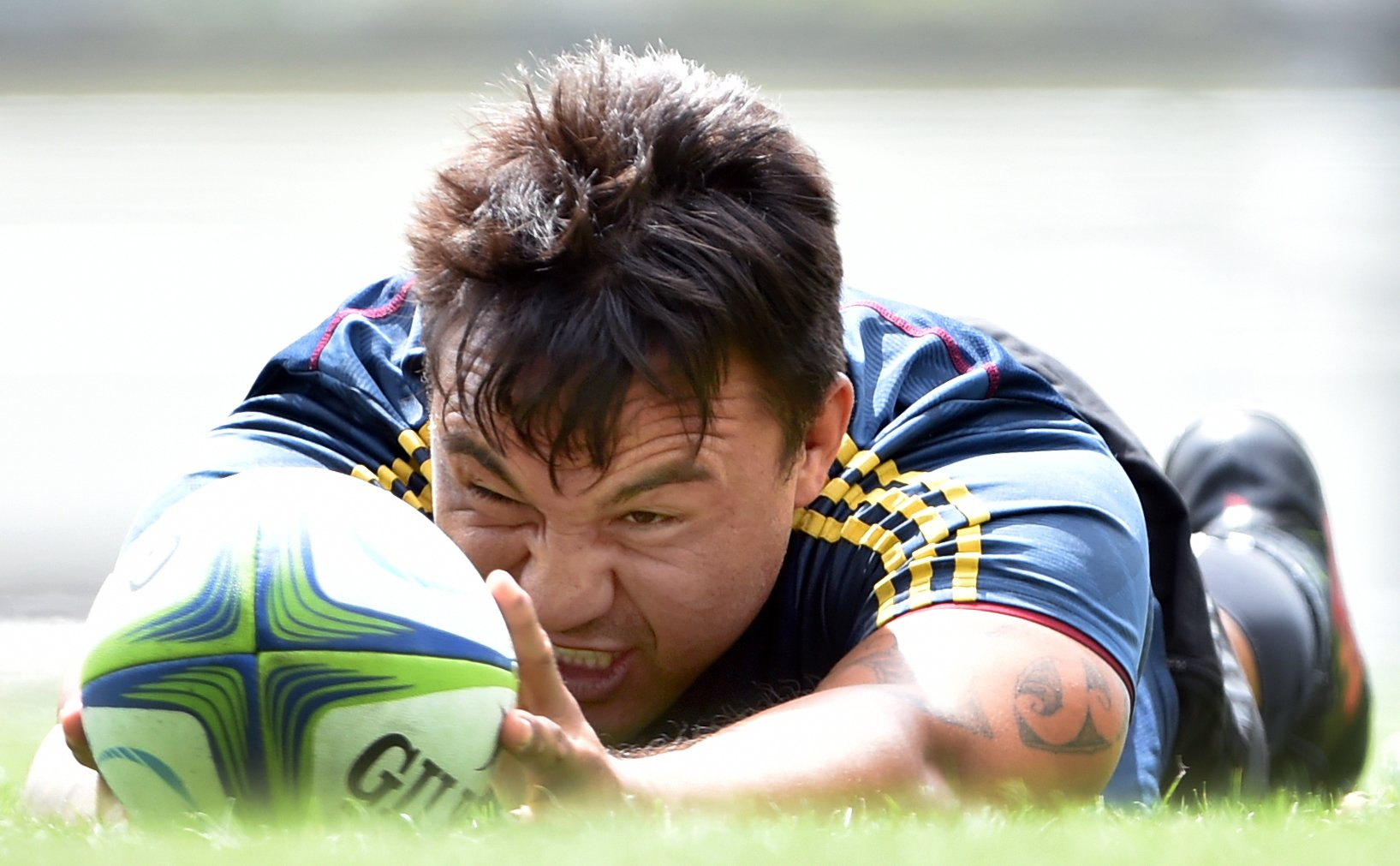 Highlanders hooker Ash Dixon gets into training at Logan Park earlier this week.PHOTO: PETER...