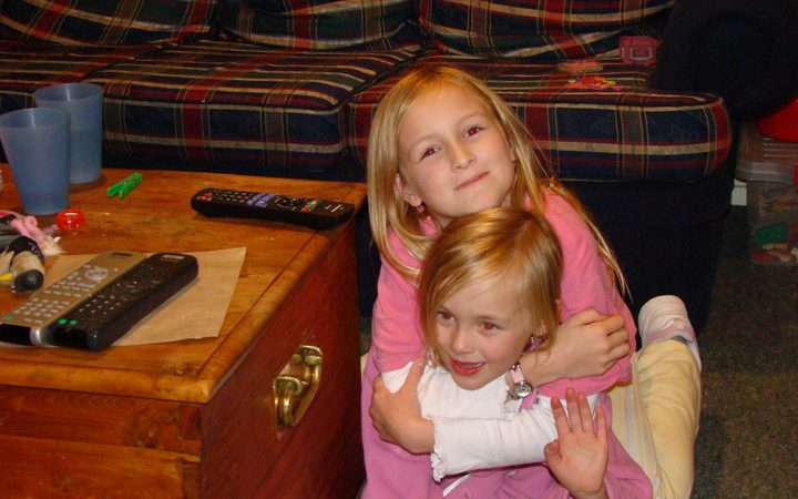 Ashley was at 8 when PTSD set in. She's pictured with her little sister Phie. Photo: Supplied