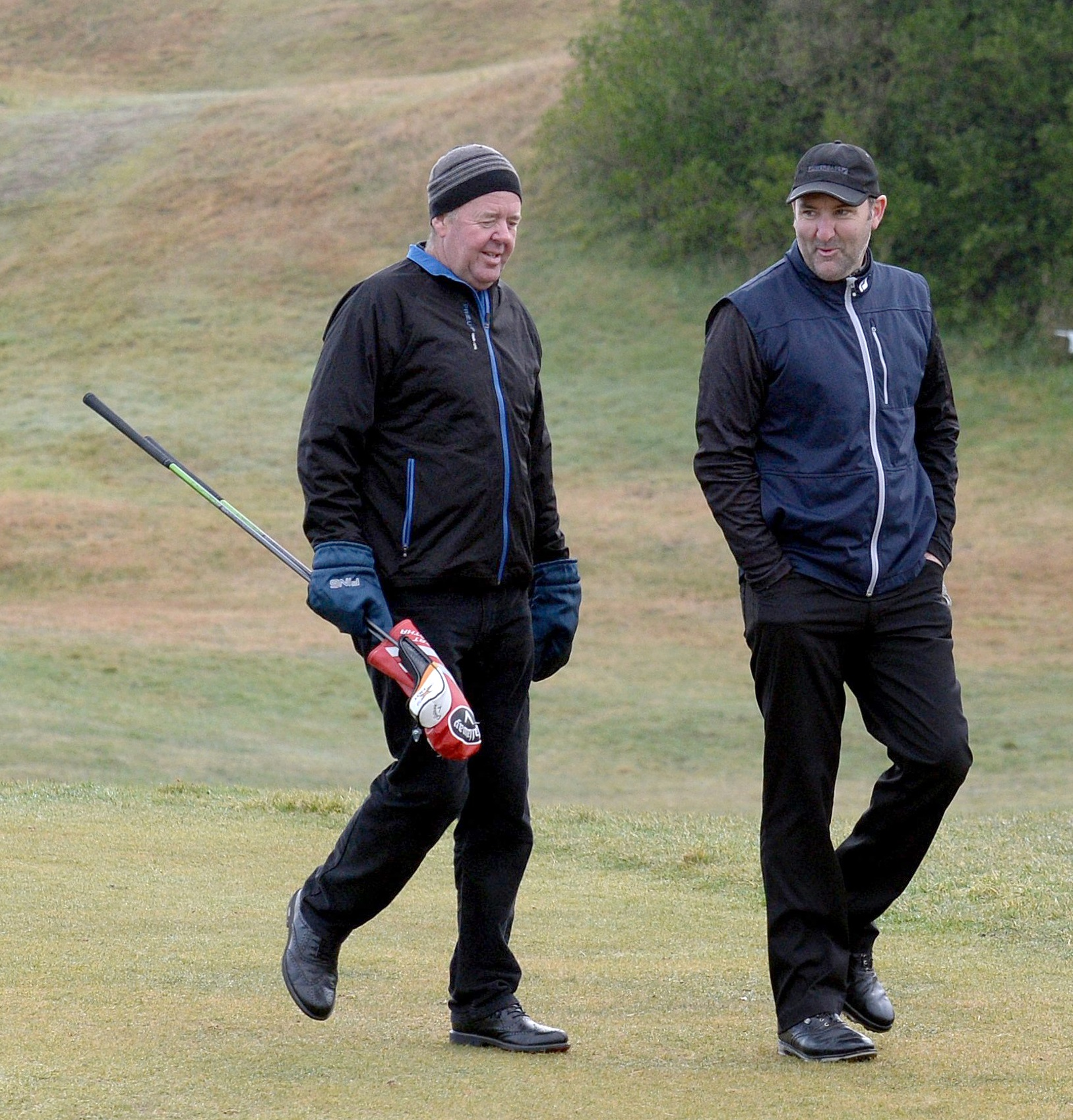Greg Turner (left) and Mahal Pearce at a golf event at Chisholm Park links in 2016.PHOTO: LINDA...