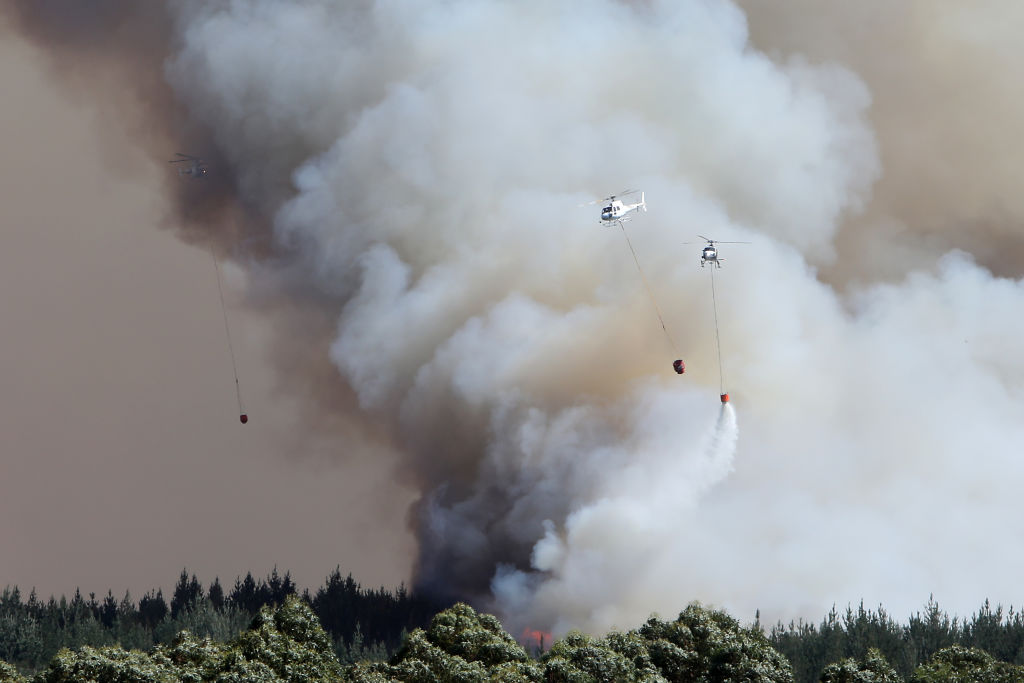 Helicopter crews battle the huge blaze. Photo: Getty
