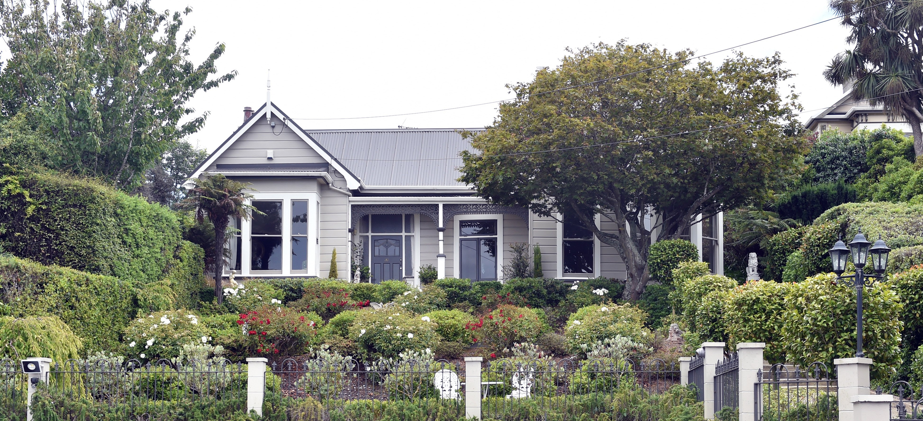 Built in the 1890s, this elevated Dunedin home offers city and sea views from its front veranda....