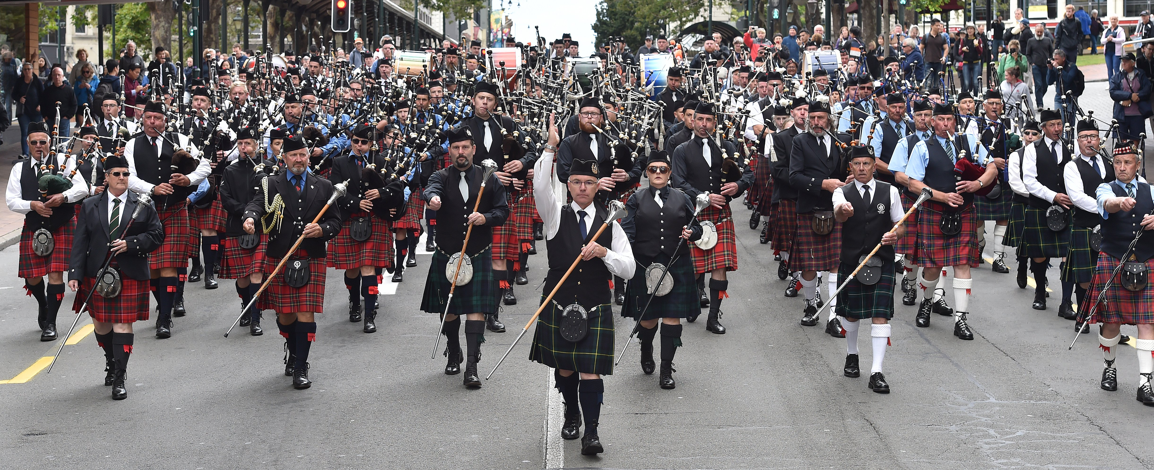 City of Dunedin Pipe Band drum major Andrew McLellan leads a mass parade of pipe band members...