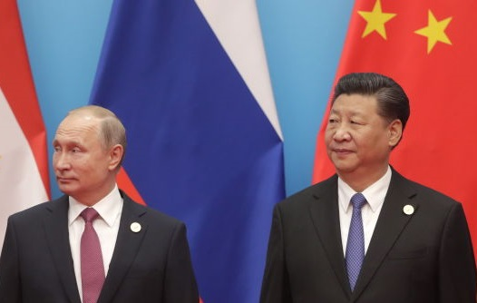 Russia's President Vladimir Putin and the President of the People's Republic of China, Xi Jinping...
