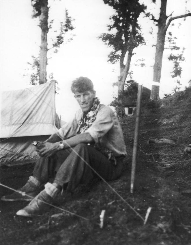 Sir Edmund Hillary sits at base camp, preparing for his successful attempt to be the first to...