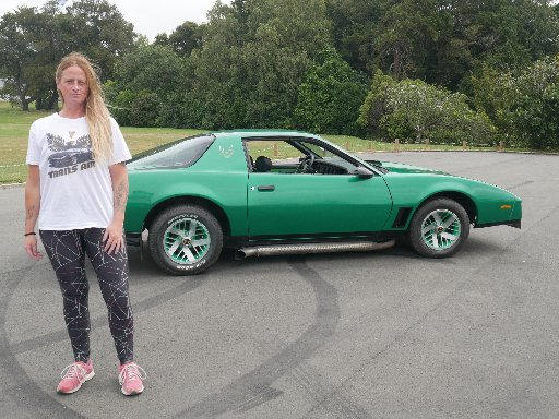 Green machine ... Kelly Spiers with her Pontiac Firebird Trans Am, which will make its car show...