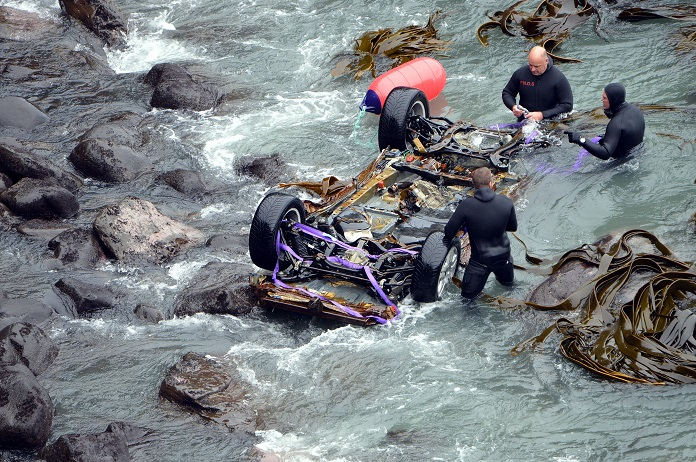 The Volkswagen Touareg belonging to John Beckenridge is recovered from the sea near Curio Bay in...