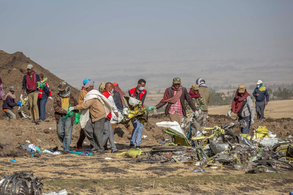 Rescuers work at the scene of the Ethiopian Airlines flight crash near Bishoftu south of Addis