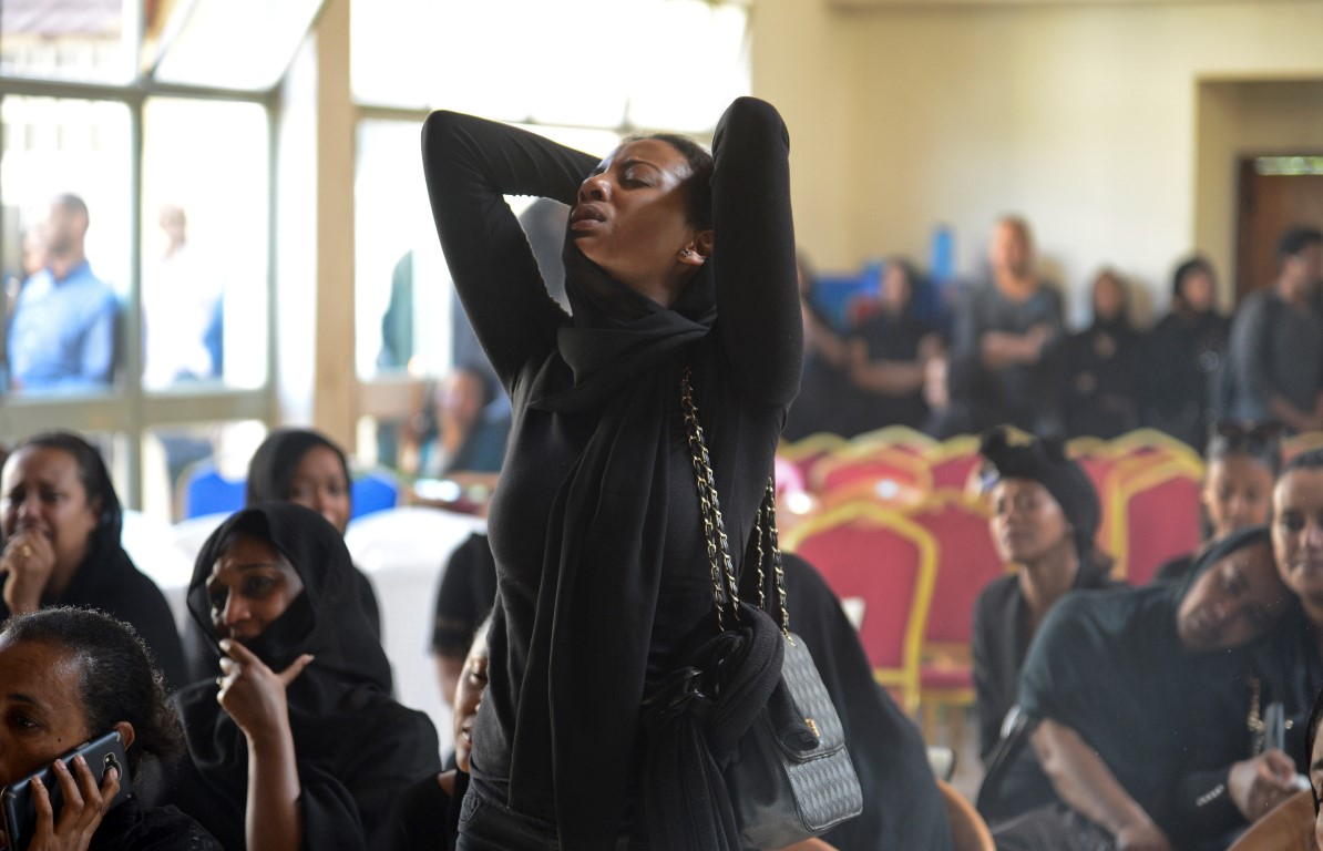 Mourners attend a memorial service held by an association of Ethiopian airline pilots in Addis
