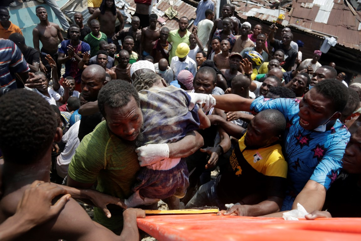 A child is rescued from the rubble of the collapsed building in Lagos. Photo: AP