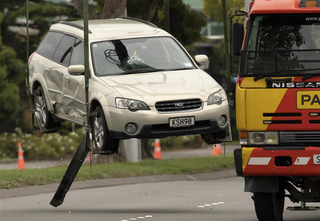 The accused gunman's car being removed from Brougham St after he was apprehended. Photo: AP