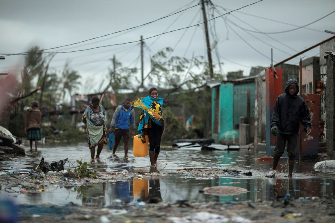 People return to Praia Nova, one of the neighbourhoods in the coastal city of Beira most affected...