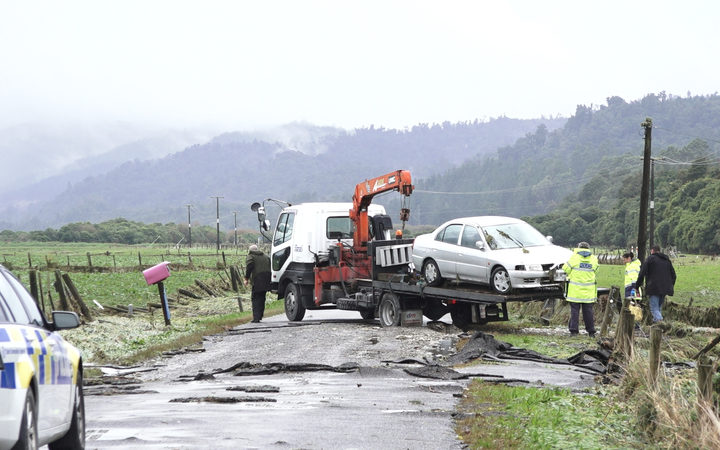 The car of a woman who died in flood waters north of Hokitika is removed. Photo: RNZ