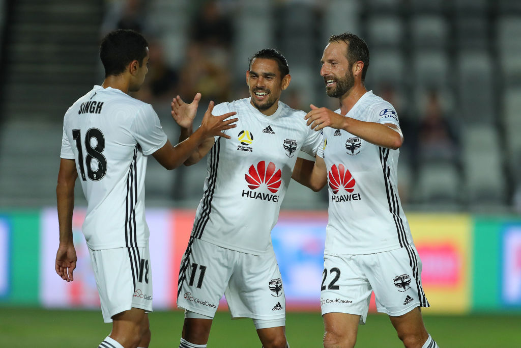 The Phoenix' David Williams celebrates a goal with teammates Andrew Durante and Sarpreet Singh....