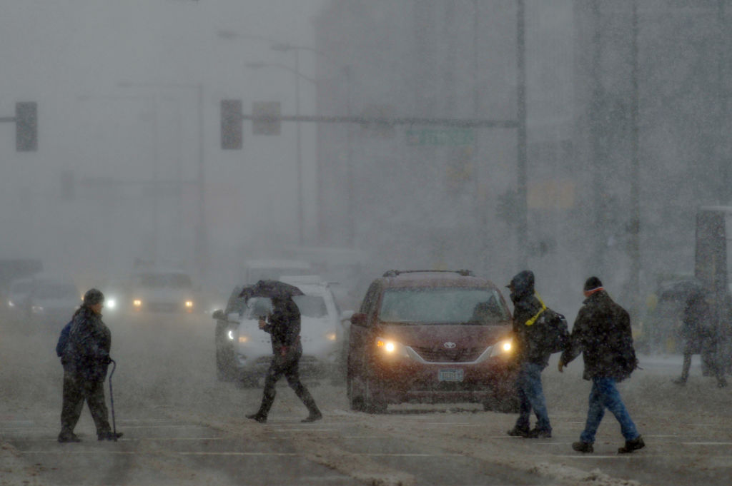 Pedestrians brave the weather in downtown Denver, Colorado. Photo: Getty Images