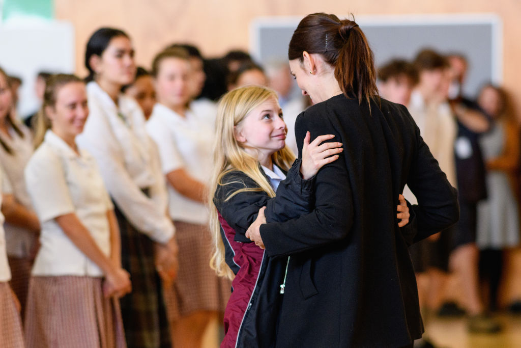 Prime Minister Jacinda Ardern receives a hug from a pupil. during her visit to Cashmere High...