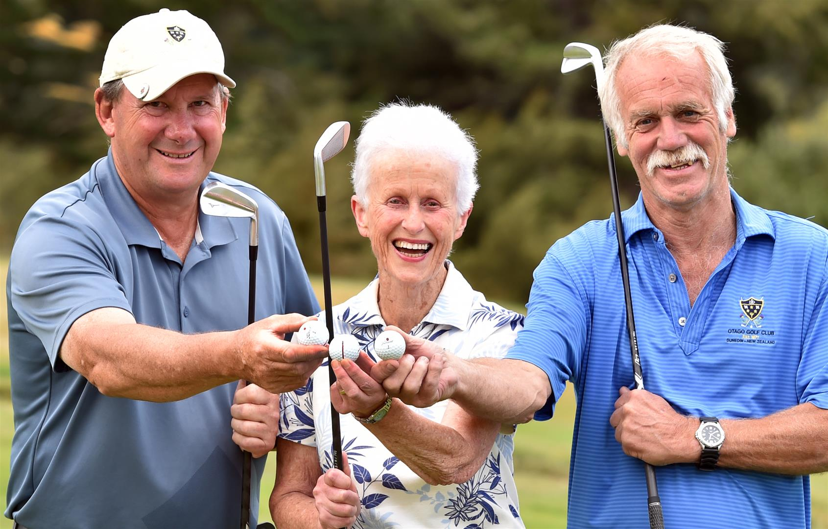 Celebrating their talents in each scoring a hole in one at the Otago Golf Club's Balmacewen course are (from left) Dean Parsons, Lillian Bartlett and Trevor King. Photo: Peter McIntosh