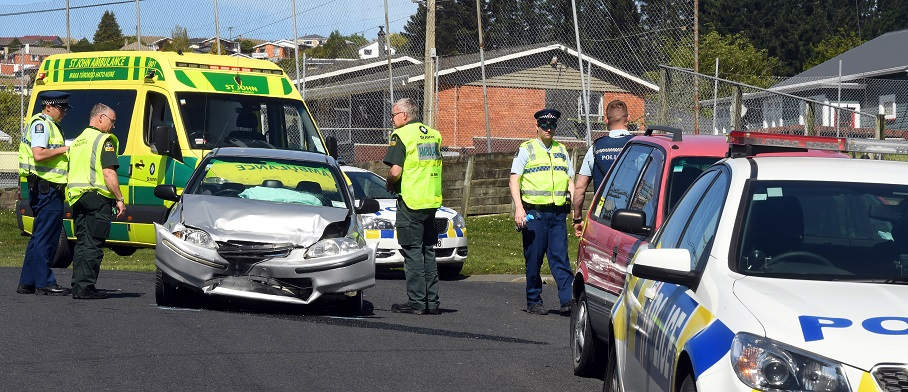 Police at the scene of a crash following a brief pursuit in Dunedin in October last year. Photo: ODT