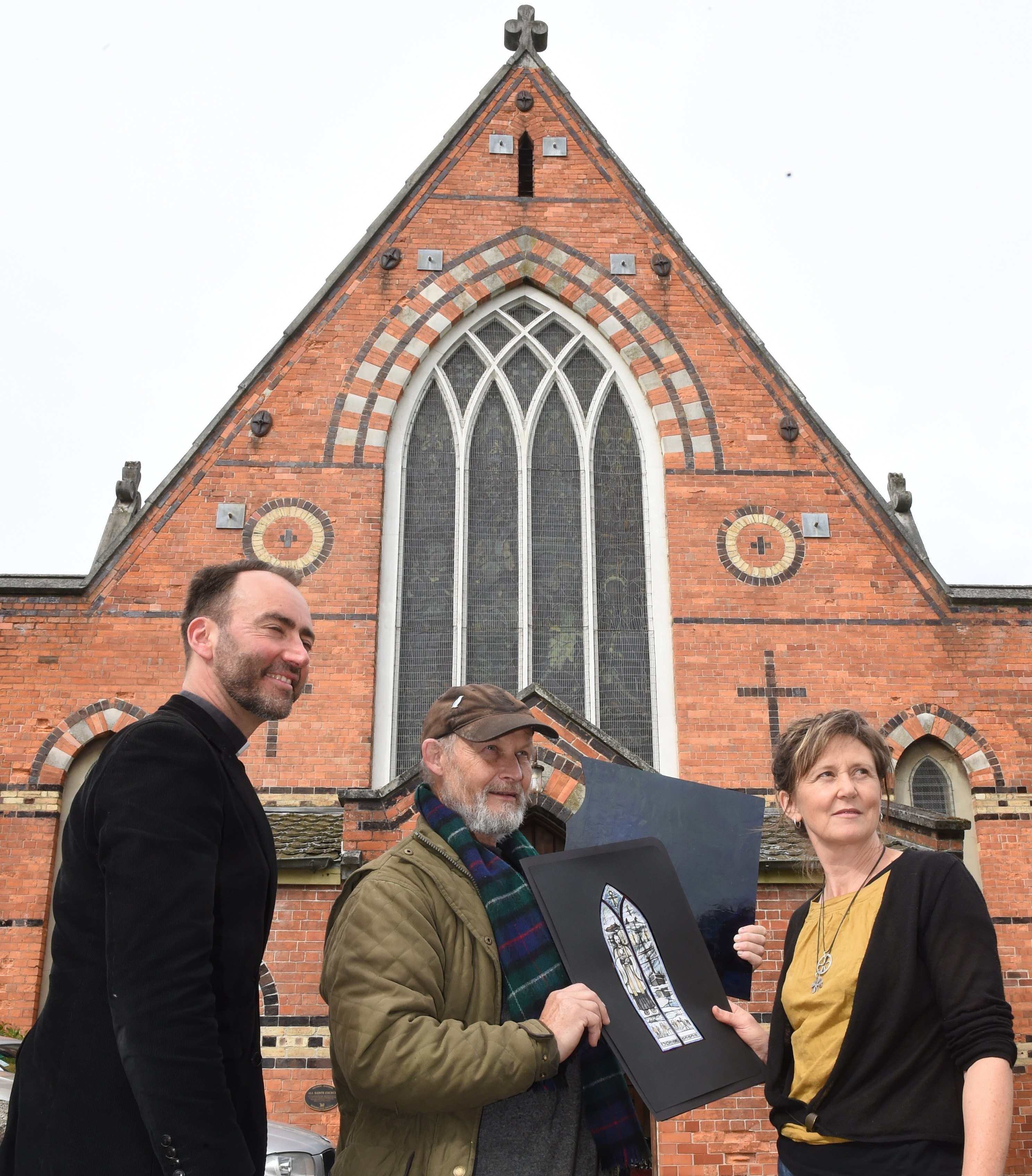 All Saints' Anglican Church vicar Canon Michael Wallace (left), stained-glass-maker Peter...