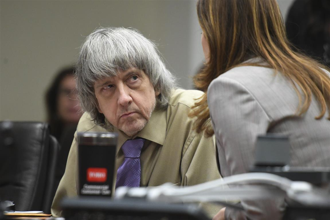 David Turpin listens to his attorney, Allison Lowe, during a sentencing hearing in Riverside,...
