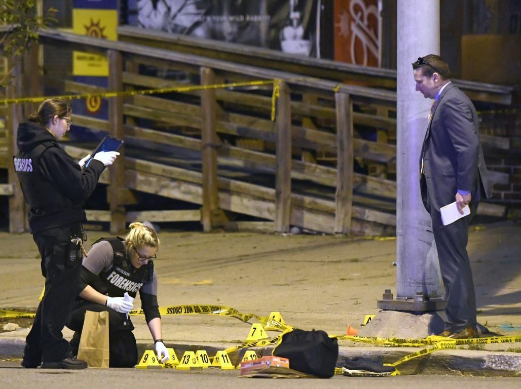 警方在巴尔的摩拍摄现场附近工作。照片:AP