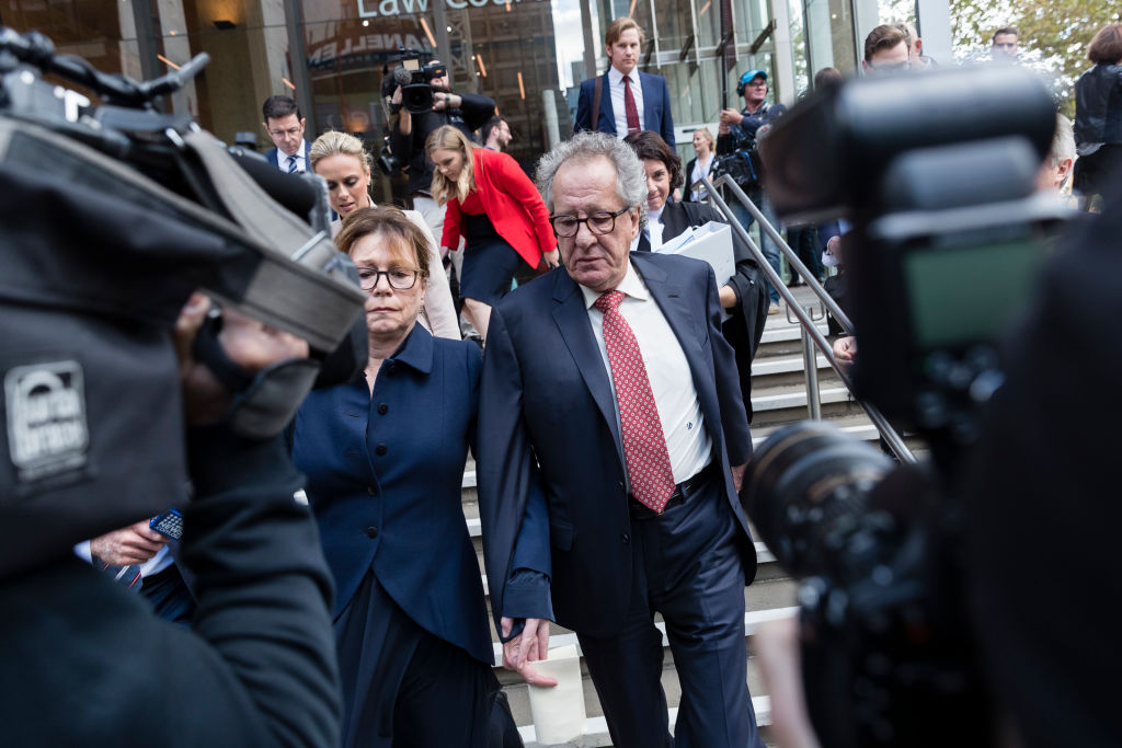 Geoffrey Rush and his wife Jane Menelaus leave the Supreme Court of New South Wales in Sydney...