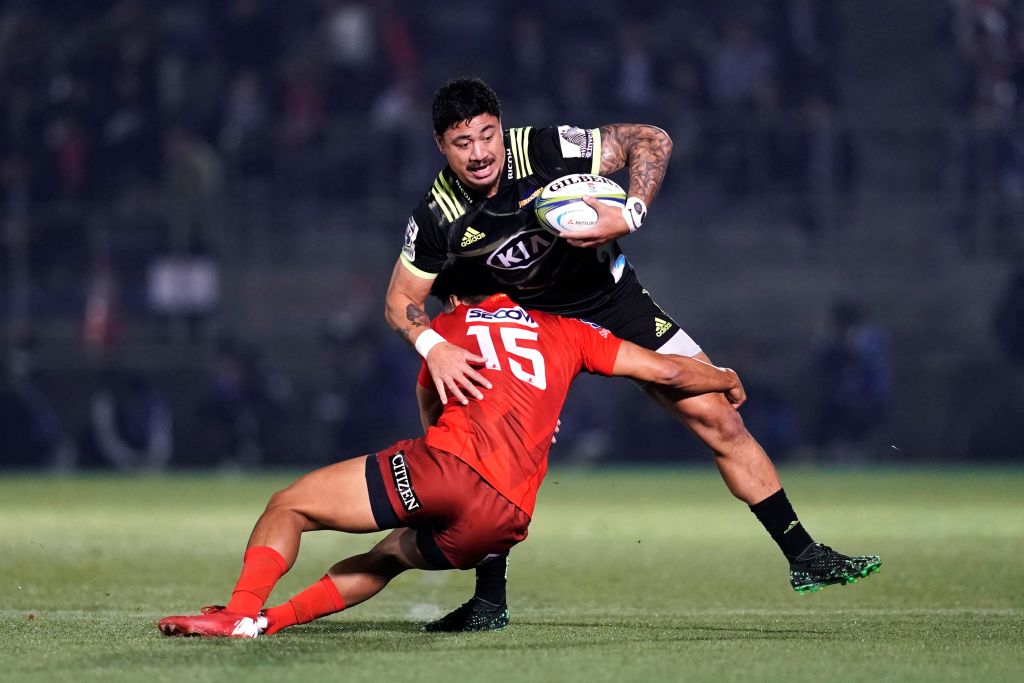 The Hurricanes' Ben Lam is tackled by the Sunwolves' Ryohei Yamanaka. Photo: Getty