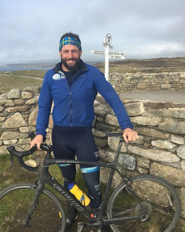 Carl Hayman at Land's End in England after completing a cycle ride for charity in 2019. Photo via...