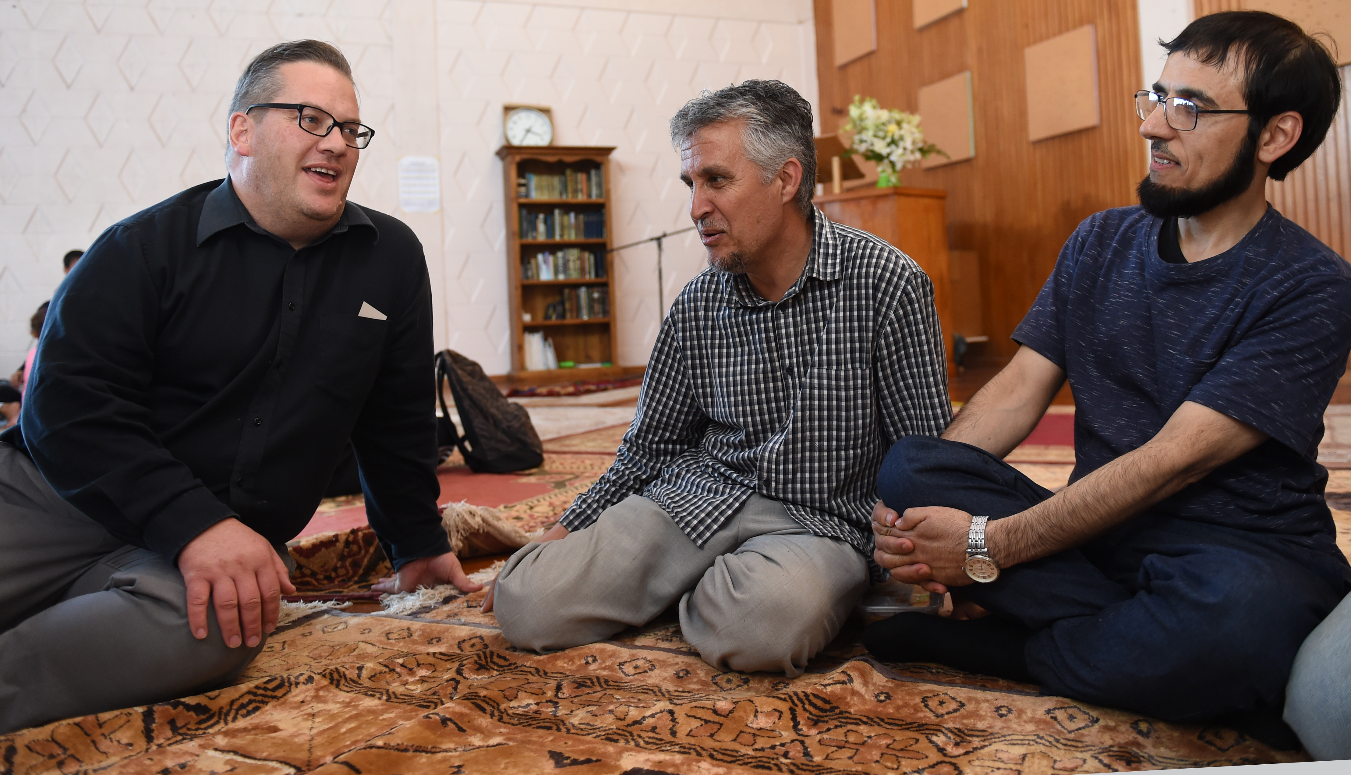 Enjoying the open day at Al Huda mosque in Dunedin yesterday are (from left) Charles Shaw, Essa...