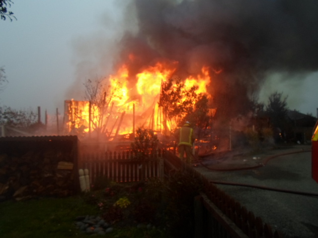 Firefighters tackle the blaze on Friday. Photo: Supplied