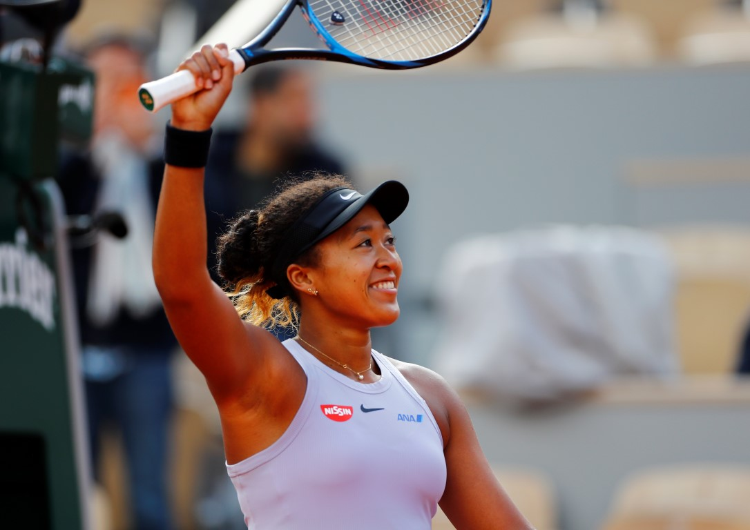 Naomi Osaka acknowledges the crowd after winning her first round match against Slovakia's Anna...