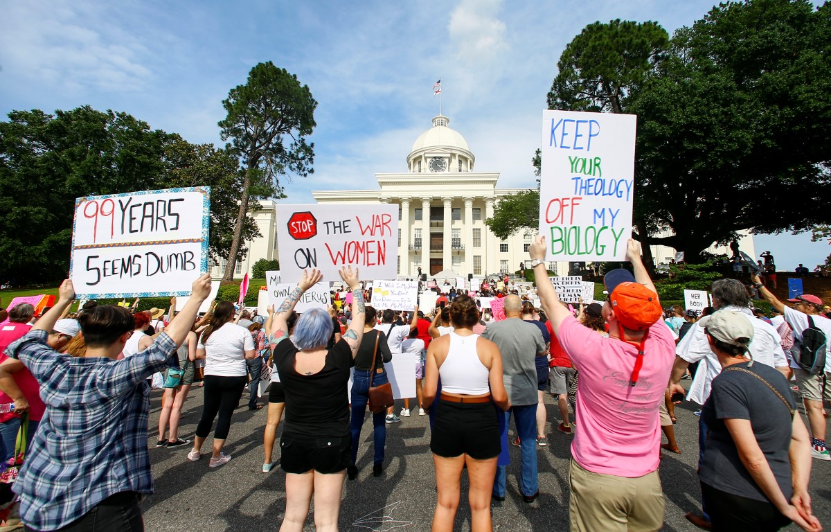 Protesters for women's rights hold a rally on the Alabama Capitol steps to protest a law week...