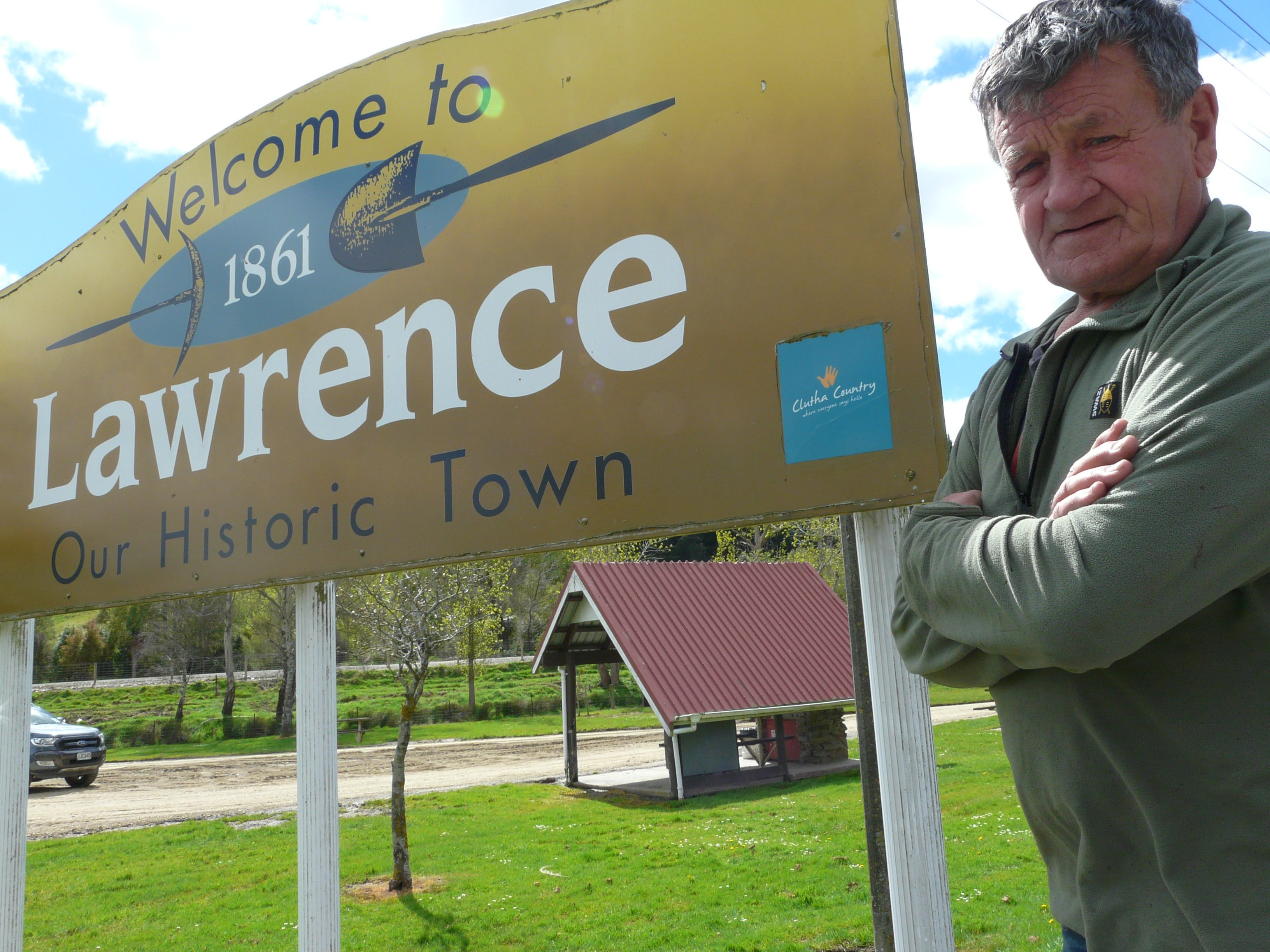 Lawrence-Tuapeka Community Board member Geoff Davidson by the South Otago town's sign last October. Photo: Laura Smith